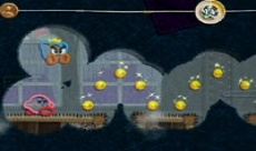 Review Kirby's Epic Yarn: Kirby strijd in de multi-player samen met de Prince Fluff.