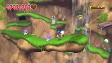 Review Klonoa: Op de achtergrond zie je een ander gedeelte van het level waar je ook doorheen zult komen!