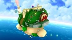 """Review Super Mario Galaxy 2: De """"overworld"""" is flink veranderd: je reist nu in 2D stijl van galaxy naar galaxy met dit schip, wat verrassend veel op Mario's hoofd lijkt!"""