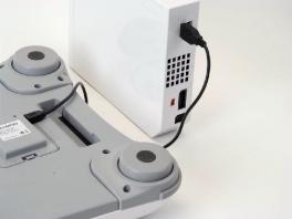 Je kunt de USB-kabel gewoon in je Wii en de batterij steken en je Board zal probleemloos werken.