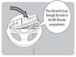De <a href = https://www.mariowii.nl/wii_spel_info.php?Nintendo=Wii-afstandsbediening>Wii Remote</a> gaat in het stuurtje zonder Wii Remote Jacket. Het polsbandje moet z&oacute;!